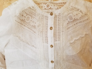 The detail of the lace patterns on this Anthropoglogie top.