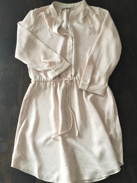 A dress shirt in blush and grey colors by Babaton, an Aritzia brand.