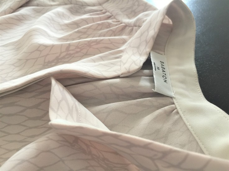 A shirt dress with drawstring in light pink color by Aritzia.