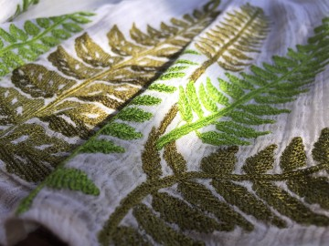 Fern embroideries in two shades of green on Botanical Peasat Top by Ranna Gill from Anthropologie