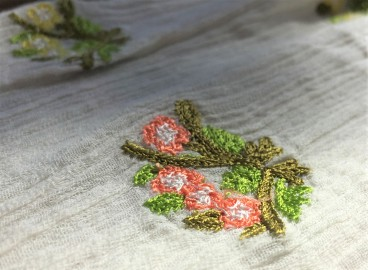 Flower embroidery details on Botanical Peasant Top by Ranna Gill from Anthropologie