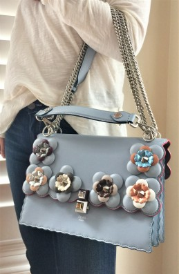Blue bag with flower embellishments with multi straps by Fendi