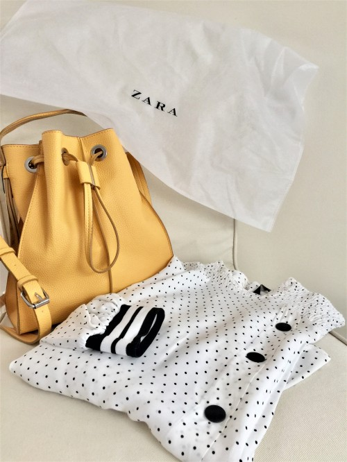 Yellow bucket bag and a black and white polka dot blouse with stripe details from ZARA