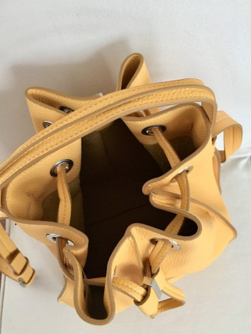 Top view of ZARA yellow bucket bag